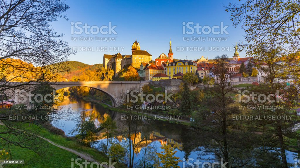 Colorful town and Castle Loket over Eger river in the near of Karlovy Vary, Czech Republic stock photo