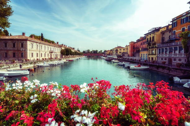 colorful town of peschiera del garda in italy. - milano foto e immagini stock