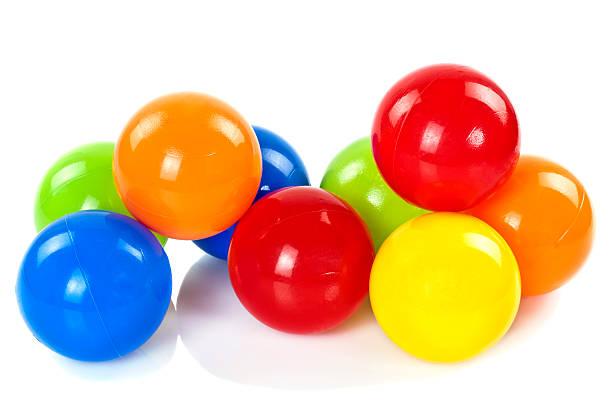 bunte spielzeug-bälle - kunststoff farbe stock-fotos und bilder