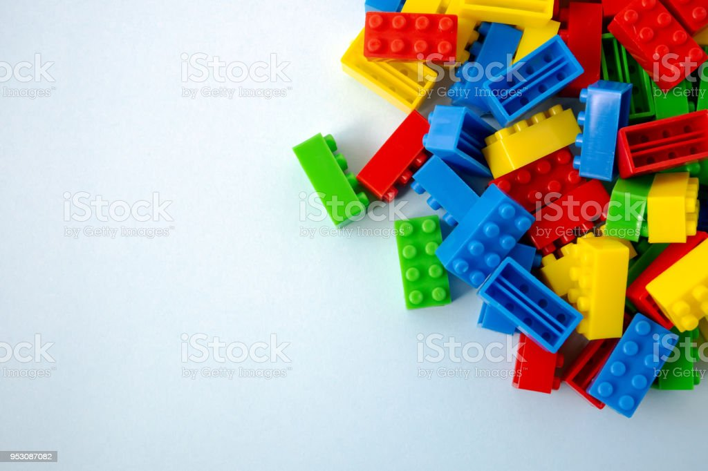 Colorful toy building blocks on blue background stock photo