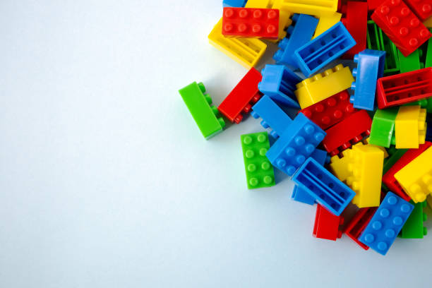 colorful toy building blocks on blue background - toy block stock pictures, royalty-free photos & images