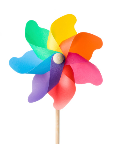 Colorful toy windmill on a white background