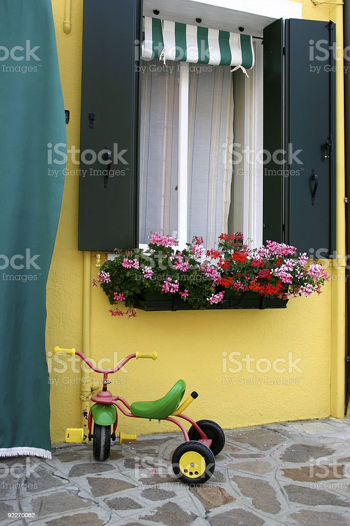 colorful toybike and window royalty-free stock photo