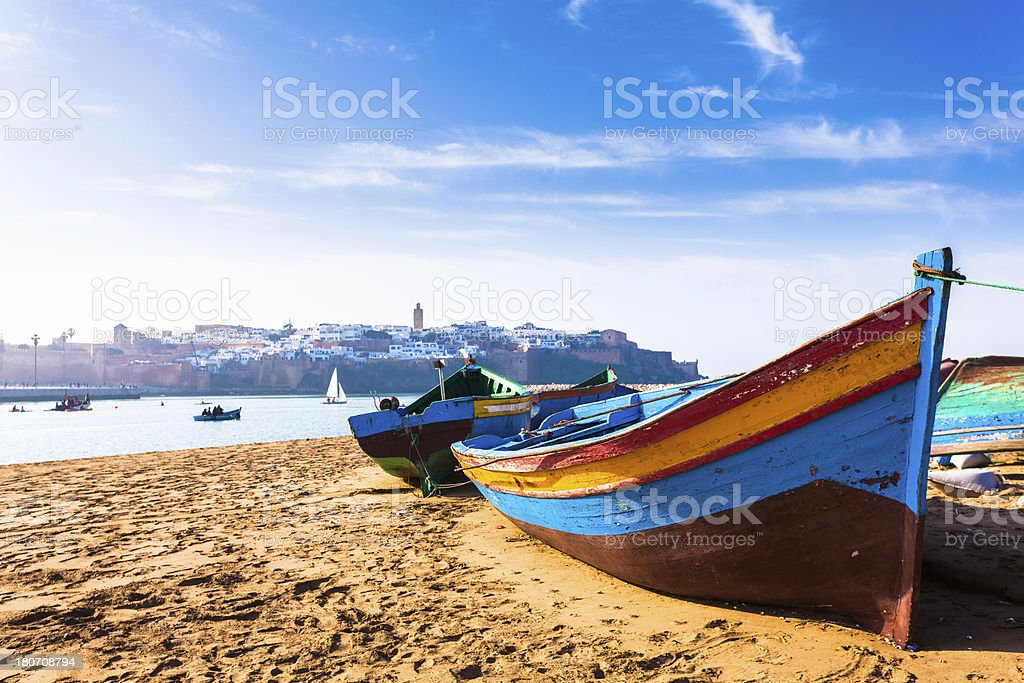 Colorful Traditional Boats along the Beach in Rabat, Morocco stock photo