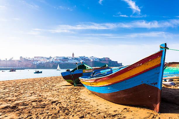 colorful traditional boats along the beach in rabat, morocco - rabat marocko bildbanksfoton och bilder