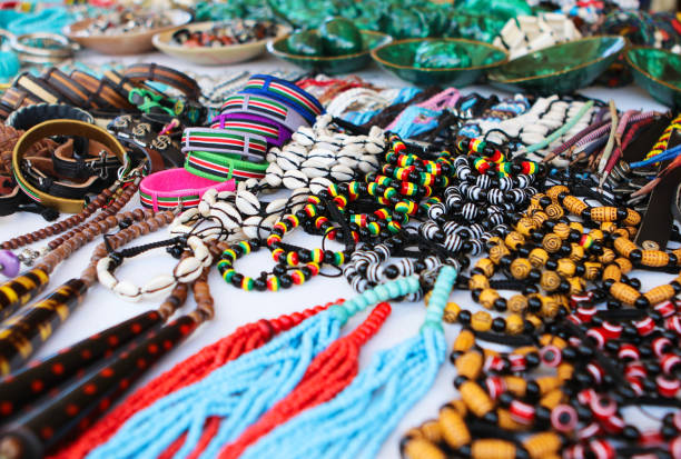 Colorful traditional handmade african beads necklaces, braceletes and other accessories at local craft market, Cape Town, Soth Africa stock photo