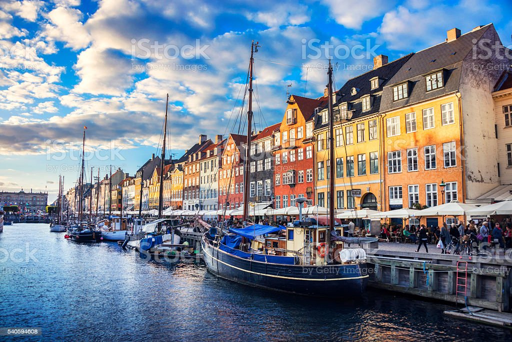 Colorful Traditional Houses in Copenhagen old Town Nyhavn at Sunset stock photo