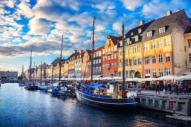 colorful traditional houses in copenhagen old town nyhavn at sunset - denmark stock photos and pictures