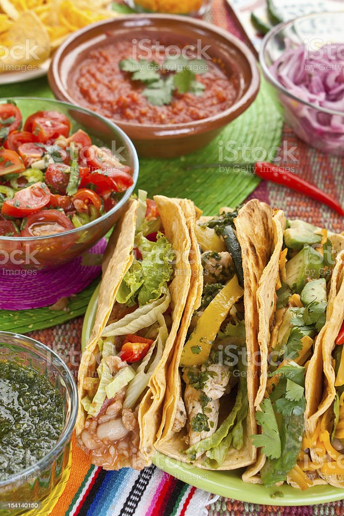 Colorful traditional Mexican food on bright tablecloths royalty-free stock photo