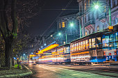Krakow, Poland - November 30, 2019: Colorful passenger tram on an autumn night street in the historic quarter of Krakow, Poland. Tourist attraction of Central Europe, an old European city