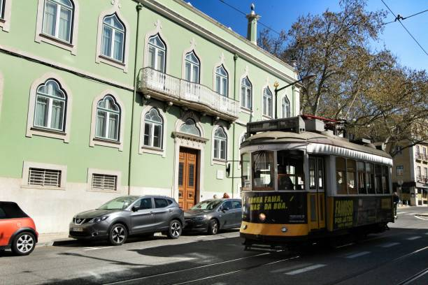 Colorful tram through the street of Lisbon in Spring – zdjęcie