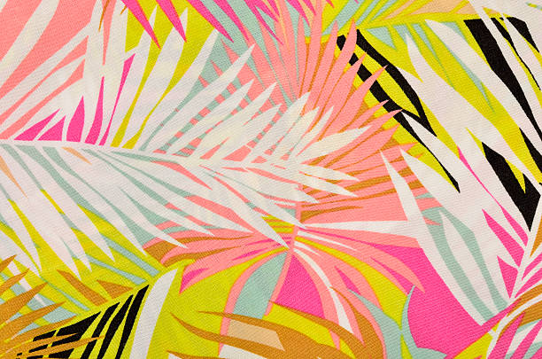 Colorful tropical leaves pattern on fabric. stock photo