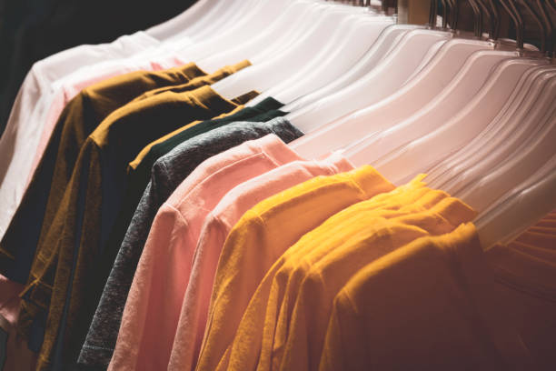 Colorful t-shirts on a hanger in fashion store Colorful t-shirts on a hanger in fashion store discount store stock pictures, royalty-free photos & images