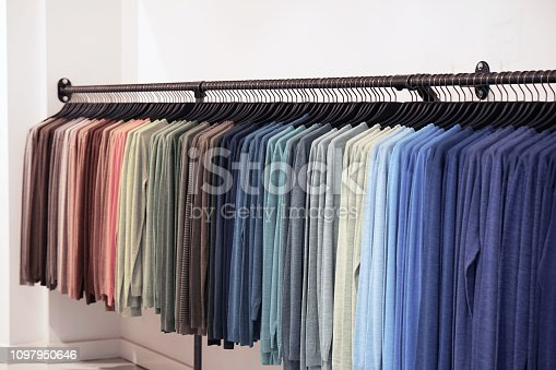 istock colorful T-shirts on hangers 1097950646