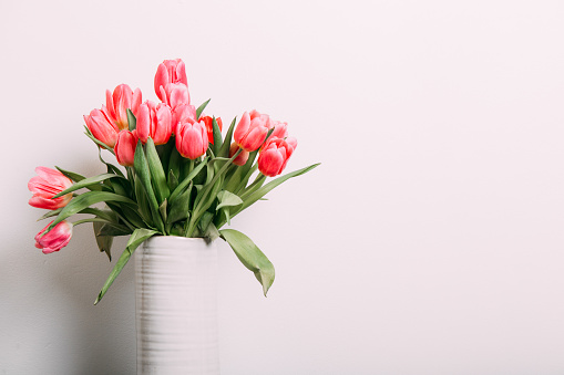 Colorful tulips easter decoration in a home. Spring concept
