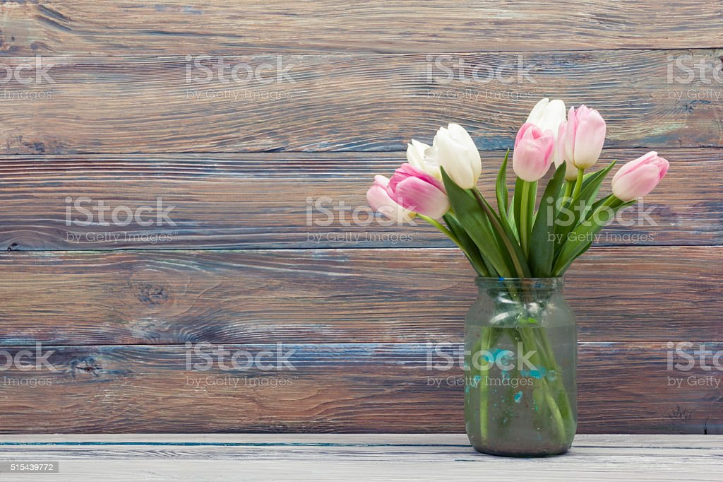 Colorful tulips flowers on wooden table. Top view with copy stock photo