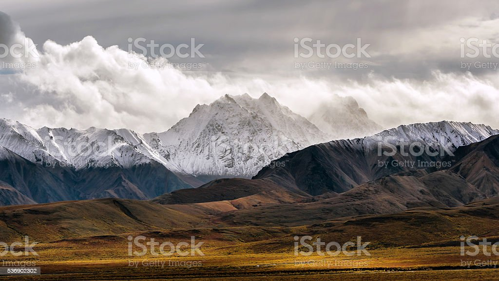 Colorful tundra and clearly marked snowline on mountains stock photo