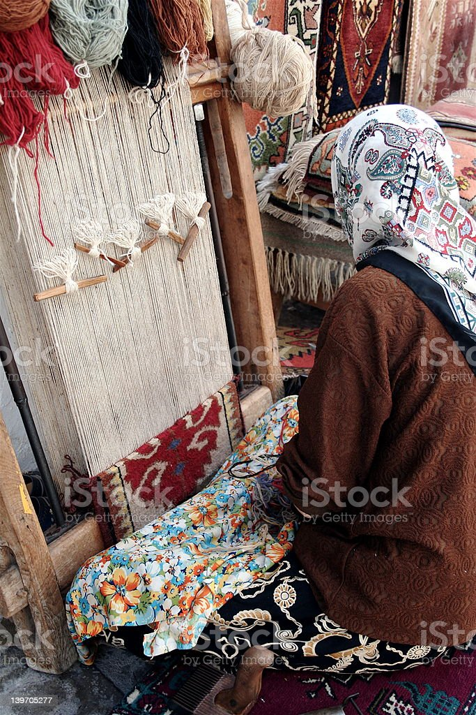 Colorful Turkish Carpet Weaver royalty-free stock photo