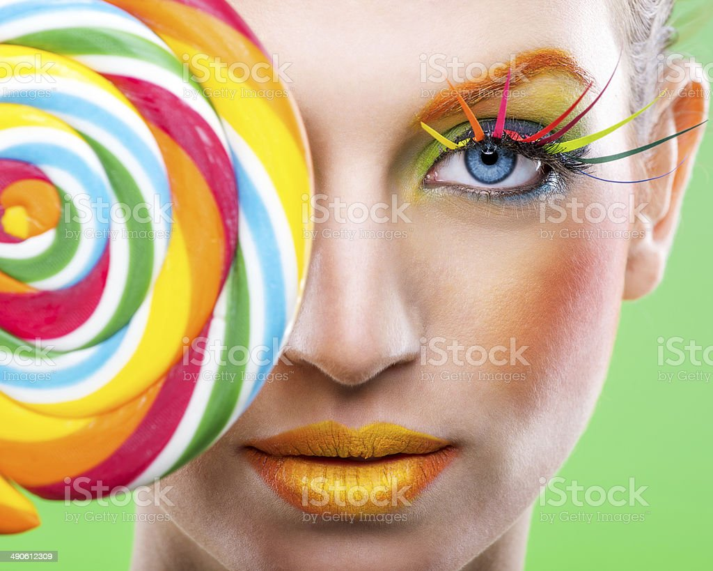 Colorful twisted lollipop, color fashion makeup stock photo
