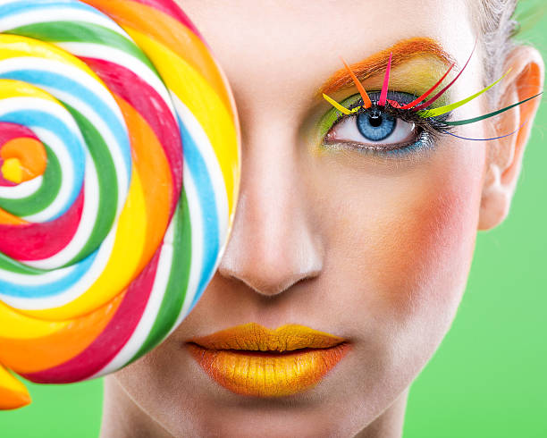 Colorful twisted lollipop, color fashion makeup stock photo
