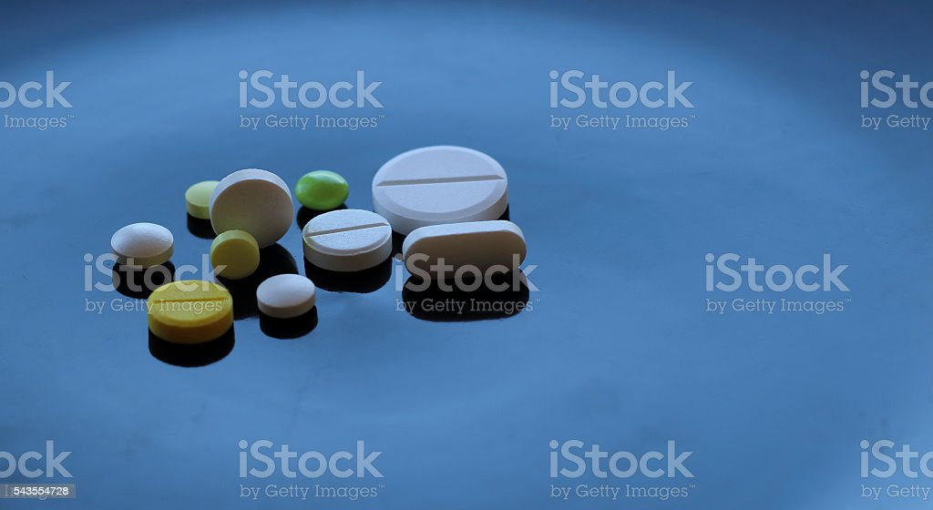 Colorful types of tablet pills detailed stock photo stock photo