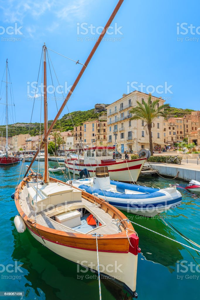 Colorful typical fishing boat in Bonifacio port, Corsica island, France stock photo
