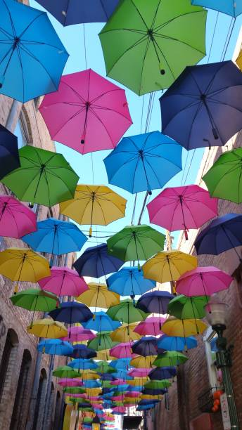 Colorful Umbrella Lined Street Colorful umbrellas along alley redlands california stock pictures, royalty-free photos & images
