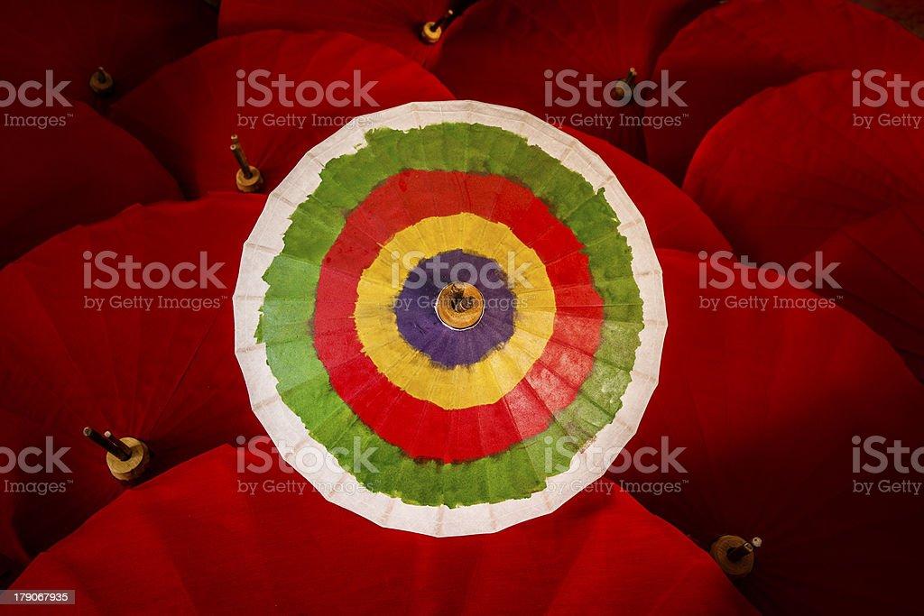 Colorful umbrella & red umbrellas. (goal, objective, target, destination) royalty-free stock photo