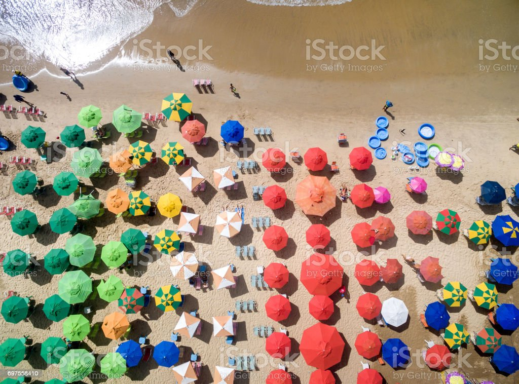 Colorful umbrellas in the beach, Brazil stock photo