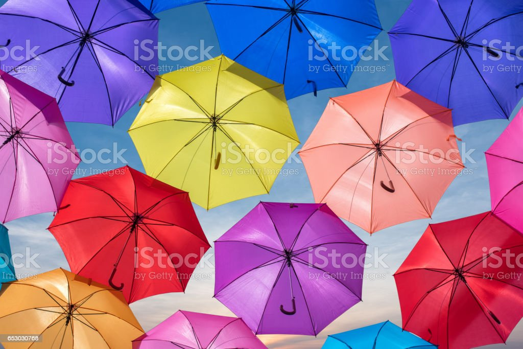 Colorful umbrellas in the sky stock photo