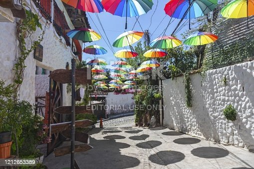 Suchitoto, El Salvador - January 17, 2019: Colorful Detail with Multi Colored Umbrellas over Old Cobblestone Residential Street
