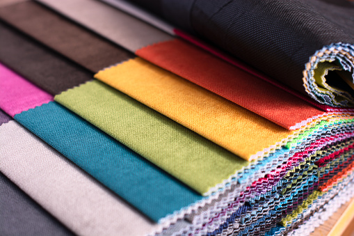 Top view of colorful upholstery fabric samples indoors