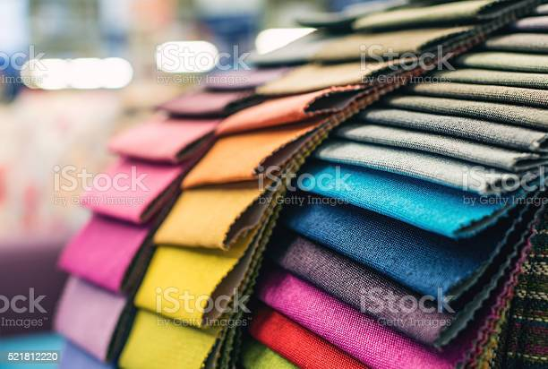 Colorful upholstery fabric samples in a furniture store.