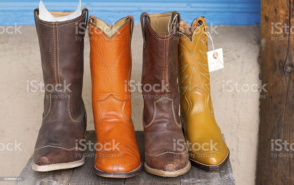 Colorful Used Cowboy Boots for Sale stock photo