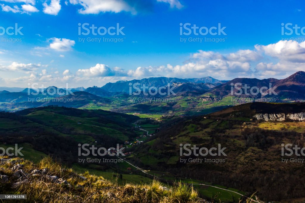 Colorful valley between lights and shadows stock photo