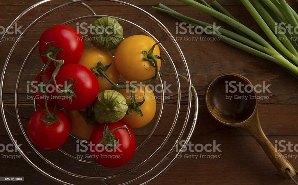 Colorful Variety of Fresh Tomatoes on Wooden Table stock photo