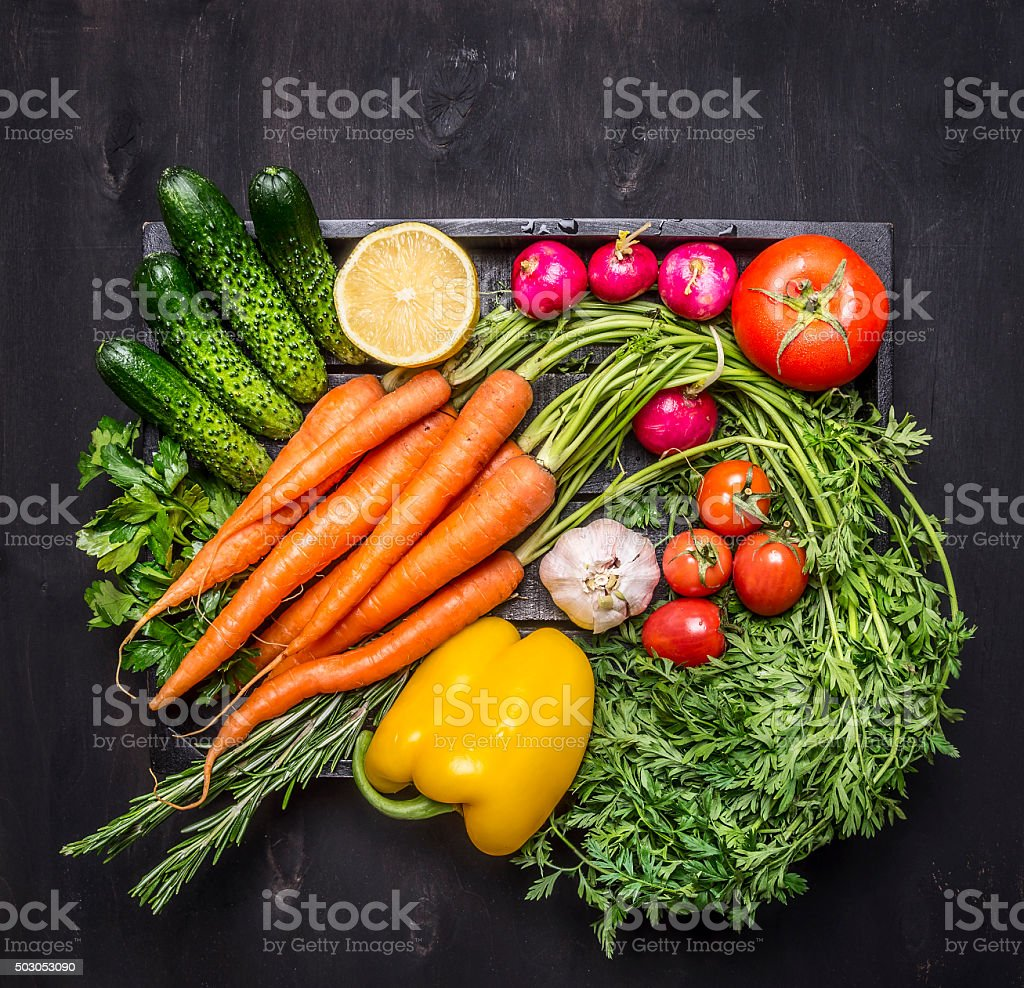 Colorful various of organic farm vegetables  wooden box  close up stock photo