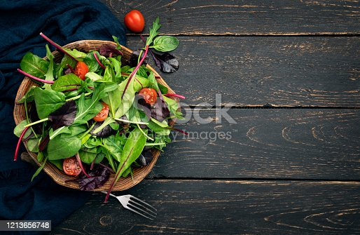 top view of a salad bowl on wooden table
