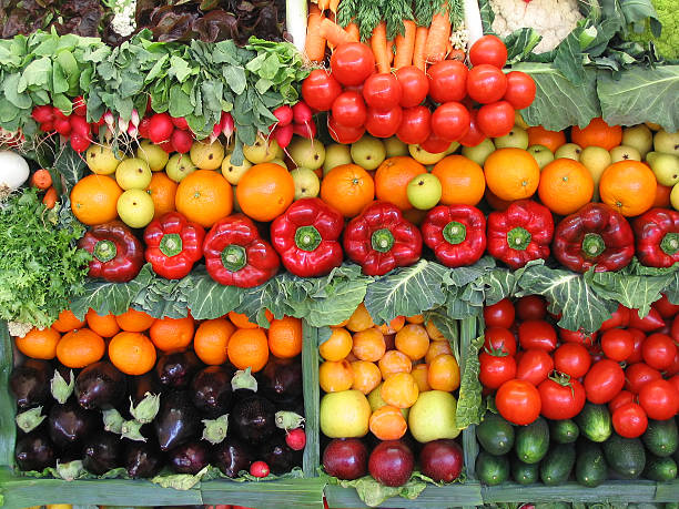 Colorful vegetables and fruits Fresh vegetables and fruits at a farmer's market. farmer's market stock pictures, royalty-free photos & images