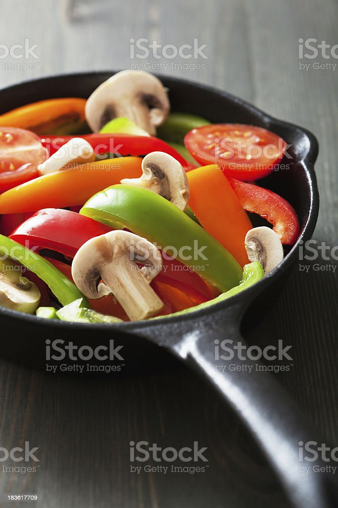 colorful vegetables in black pan ready for frying royalty-free stock photo