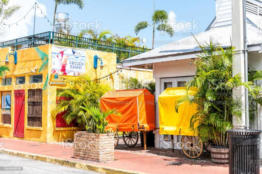 Colorful Vibrant Saturated Yellow And Orange Colors At Famous Tropical Cafe Or Restaurant Facade Exterior In Florida Travel Sunny Day Stock Photo Download Image Now Istock