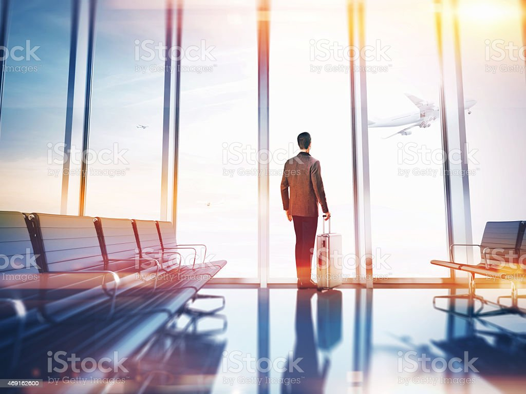 Colorful view of single businessman waiting at airport stock photo
