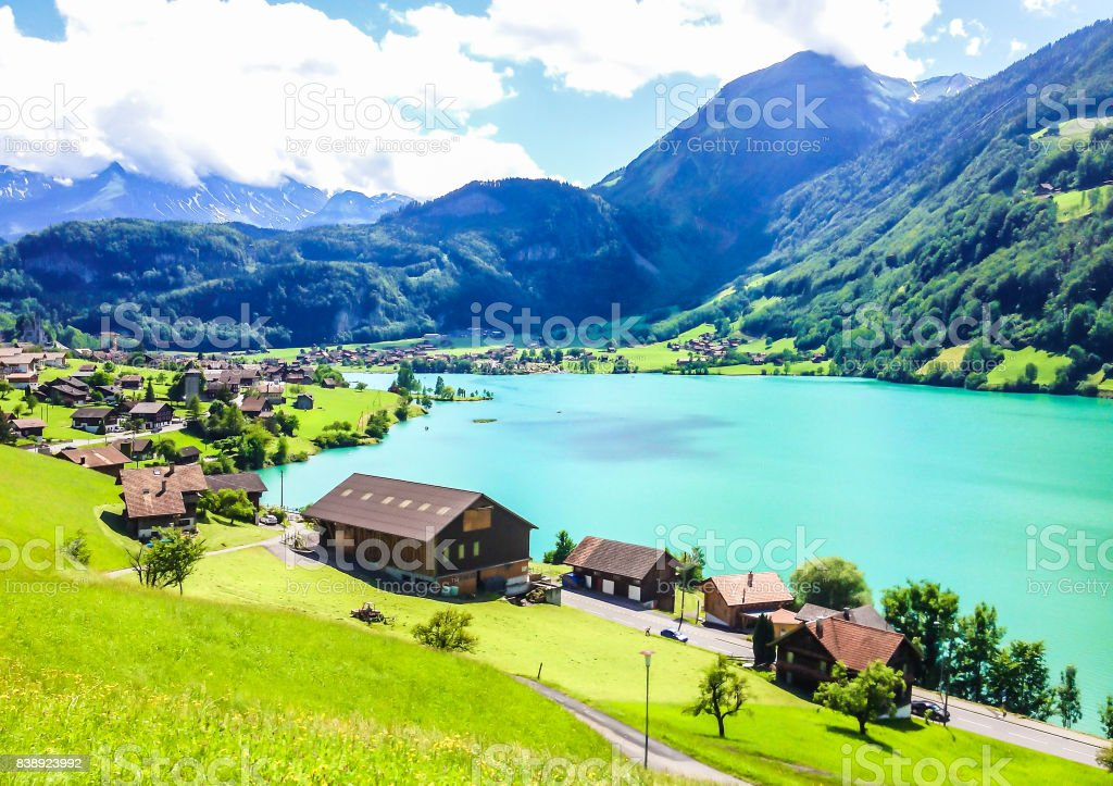 Colorful view of Thunersee (Lake Thun) in a beautiful summer day, Thun, Switzerland, Europe. stock photo