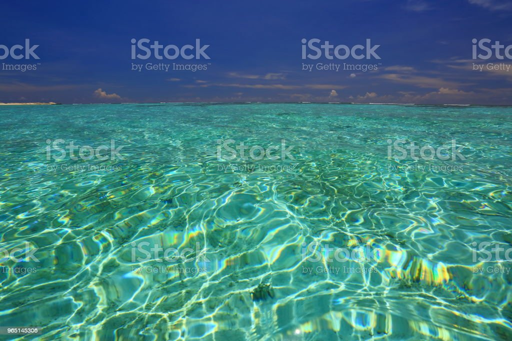Colorful view of turquoise water of Indian Ocean surface and blue sky. Beautiful background. Maldives. zbiór zdjęć royalty-free