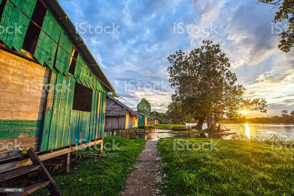 Colorful village houses and nature at sunset stock photo