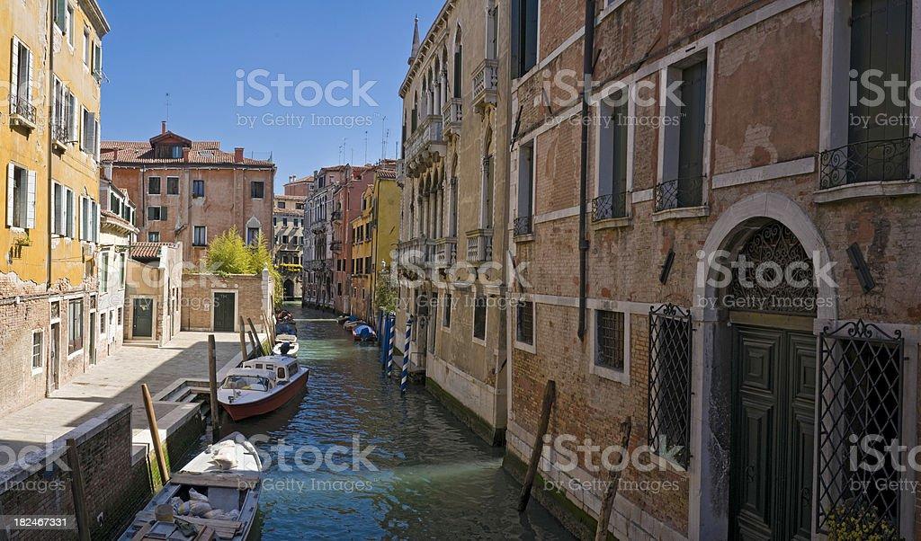 Colorful villas quiet fondementas blue canals striped poles Venice Italy royalty-free stock photo
