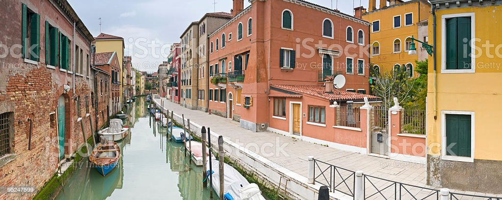 Colorful villas tranquil canal Venice stock photo