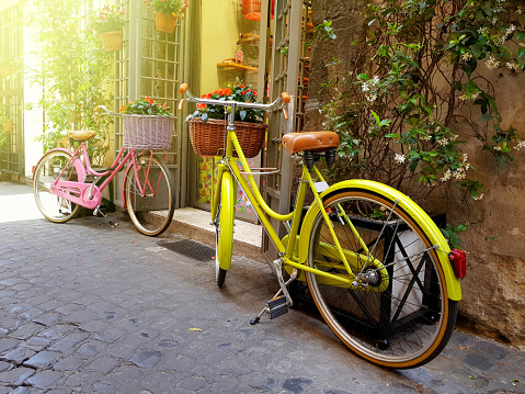 Colorful vintage bikes in old street in Rome