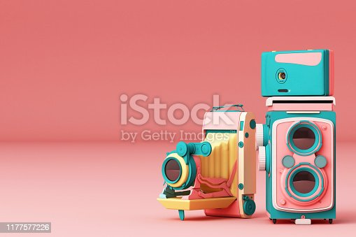 istock Colorful vintage camera on a pink background.-3d render. 1177577226