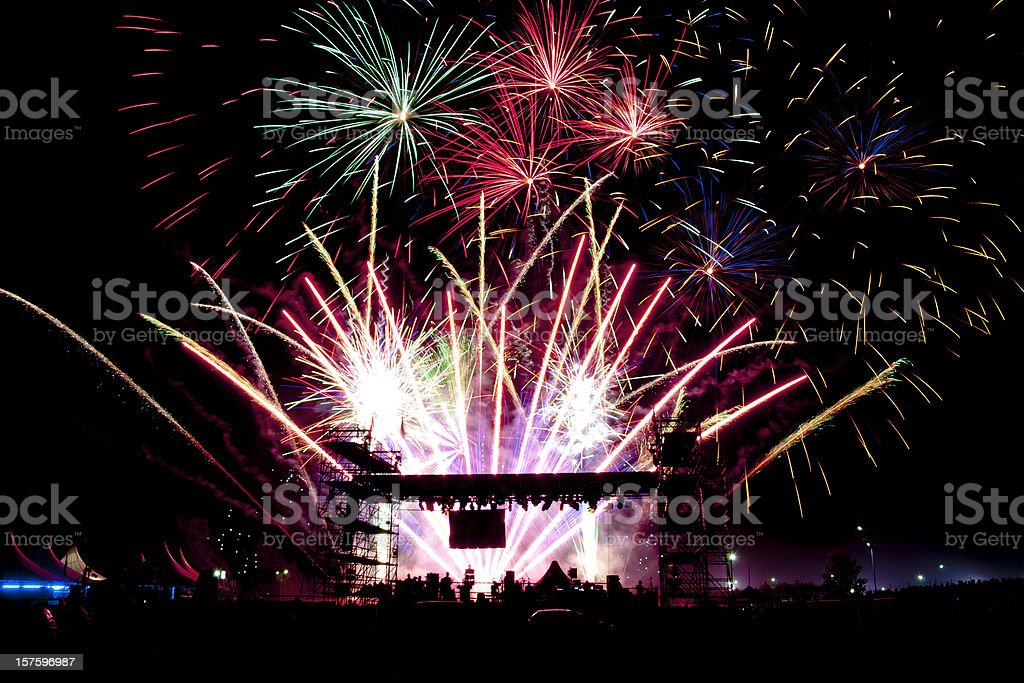 Colorful Vivid Fireworks Over the Stage of a Concert stock photo